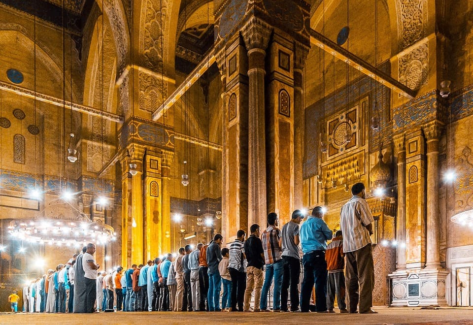 People Praying in front of Sultan Hassan Mosque